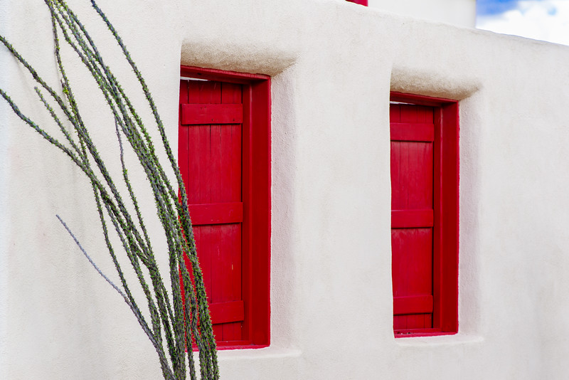 Beautiful red doors and adobe walls in Alpine, TX.