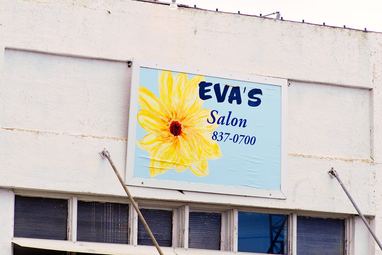 Hand painted sign for Eva's Salon in Alpine, TX