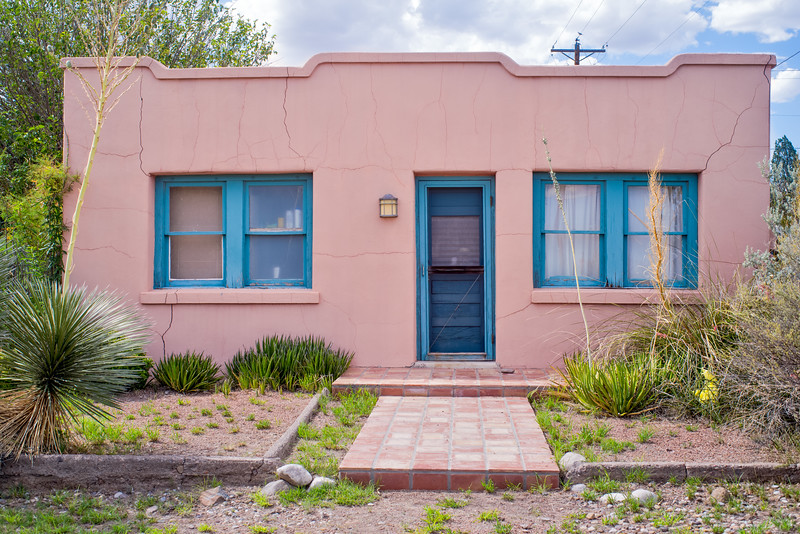 Cracked, yet colorful stucco house.