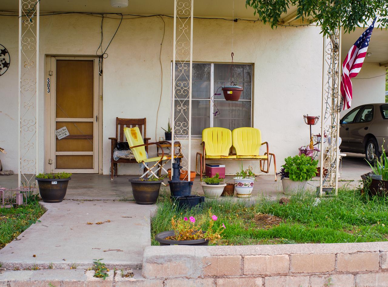 Yellow, metal patio chairs look good in Marfa, TX.