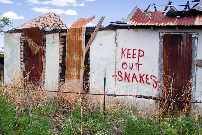 When I first read the sign, I thought it was some Marfa-esque Voo-Doo warning to snakes.