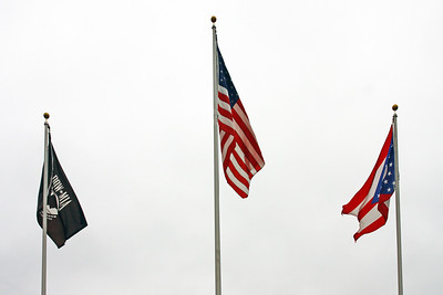 P.O.W., United States, and State of Ohio flags