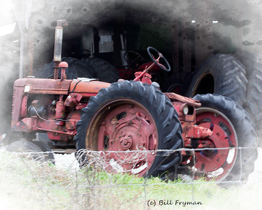 Old tractor of unknown manufacture and vintage (possibly a McCormick or Farmall from the 1950's) near West Alton, Missouri