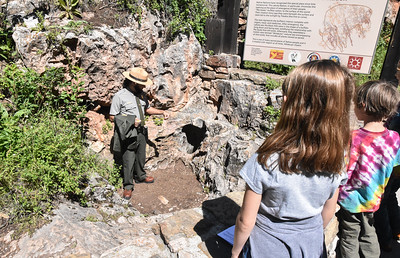 Here the guide is showing us the only natural entrance to Wind Cave.  We will go thru a man-made entrance and walk about a mile thru the cave.