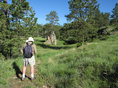 The trail eventually drops into a broad valley, with some interesting rocks.