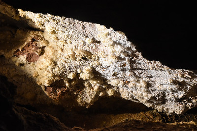 This is so-called Popcorn formation.  The cave has very few of the classic stalagtite and stalagmite formations.
