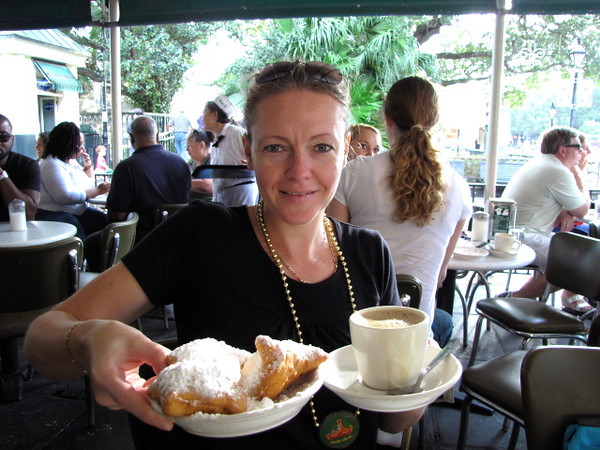 "There's Nancy about to enjoy some coffee and beignets at ""Cafe Du Monde"", a popular New Orleans hang-out... before we got to New Orleans everyone said to go here to try these tasty powdered sugar covered donuts... we're glad we did! :-)"