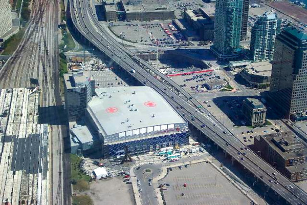 """There's Air Canada Place, home of the NHL's """"Toronto Maple Leafs"""" and the NBA's """"Toronto Raptors""""."""