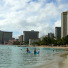 There's a shot of beautiful Waikiki beach on the popular Island of Oahu.