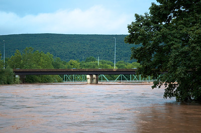 "Loyalsock Creek flowing under the I-180 bridges and just over the ""Green Bridge""  deck in Montoursville"