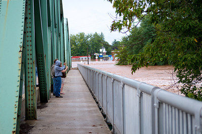 "Brave souls photographing the Loyalsock Creek from the Broad Street ""Green Bridge"" in Montoursville."