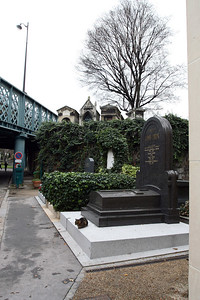 Montmartre Cemetary is full of stray cats among other things. Road bridges go right over some of the tombs now.