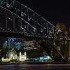 Luna Park at night through Sydney Harbor Bridge