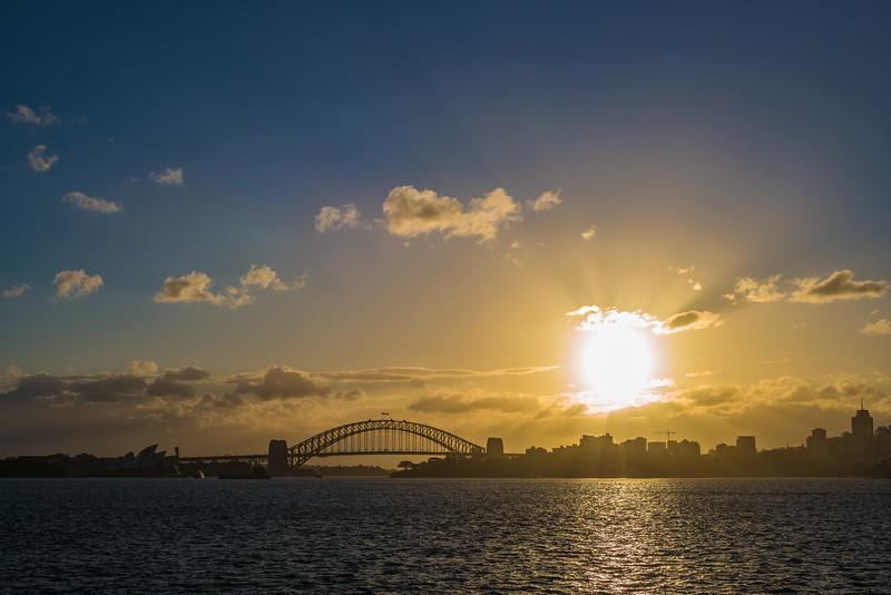 golden sunset over Sydney Harbor