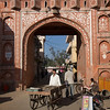 man with cart entering Pink City