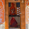 supplicant inside street micro-temple