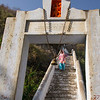 woman running down stairs at entrance to Hunuman Temple trail