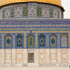 woman walking past Dome of the Rock