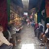 men in conversation Arab market Jerusalem