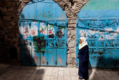 Arab woman and blue doors