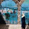 Arab woman and blue doors