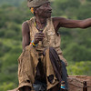 older Hadza man speaking on rock