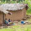 couple in mud brick house growing maize Mahale mountains