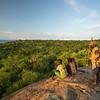 Hadza men on rock looking at Lake Eyasi 2