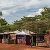 man in magenta uniform Tanzanian village