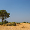 savanna near Mile w Land Cruiser in distance