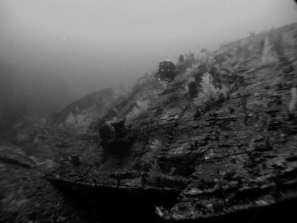 Diver swims over wreck @ 105m