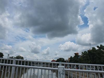 clouds crossing bridge