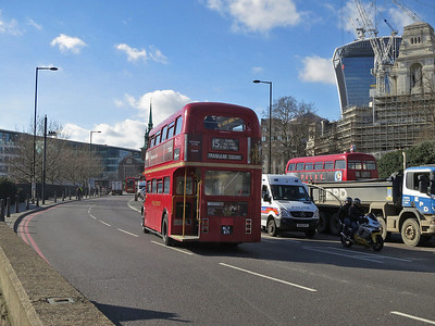 Heritage-fleet Routemaster RM871 leaves the Tower Hill stop with a Route 15 service to Trafalgar Square  - 07/03/14.