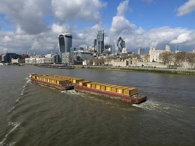 Rubbish barge  heads under Tower Bridge  - 04/03/14.
