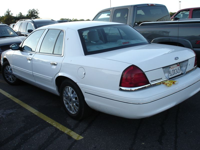 The white Crown Vic - the preferred mode of transportation on this trip.   Git-r-done