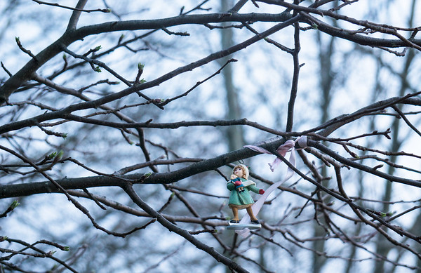 Little Girl and Doll Ornament in the Wild