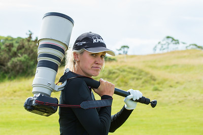 Olafia Kristinsdottir of Iceland tries her hand at carrying the big lens during a practice round