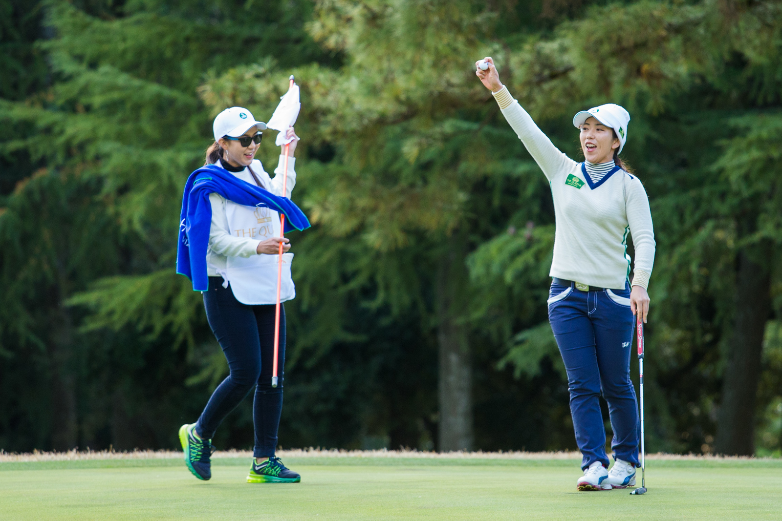 Ritsuko Ryu of Japan celebrates her win on the 16th hole during the Friday four-balls
