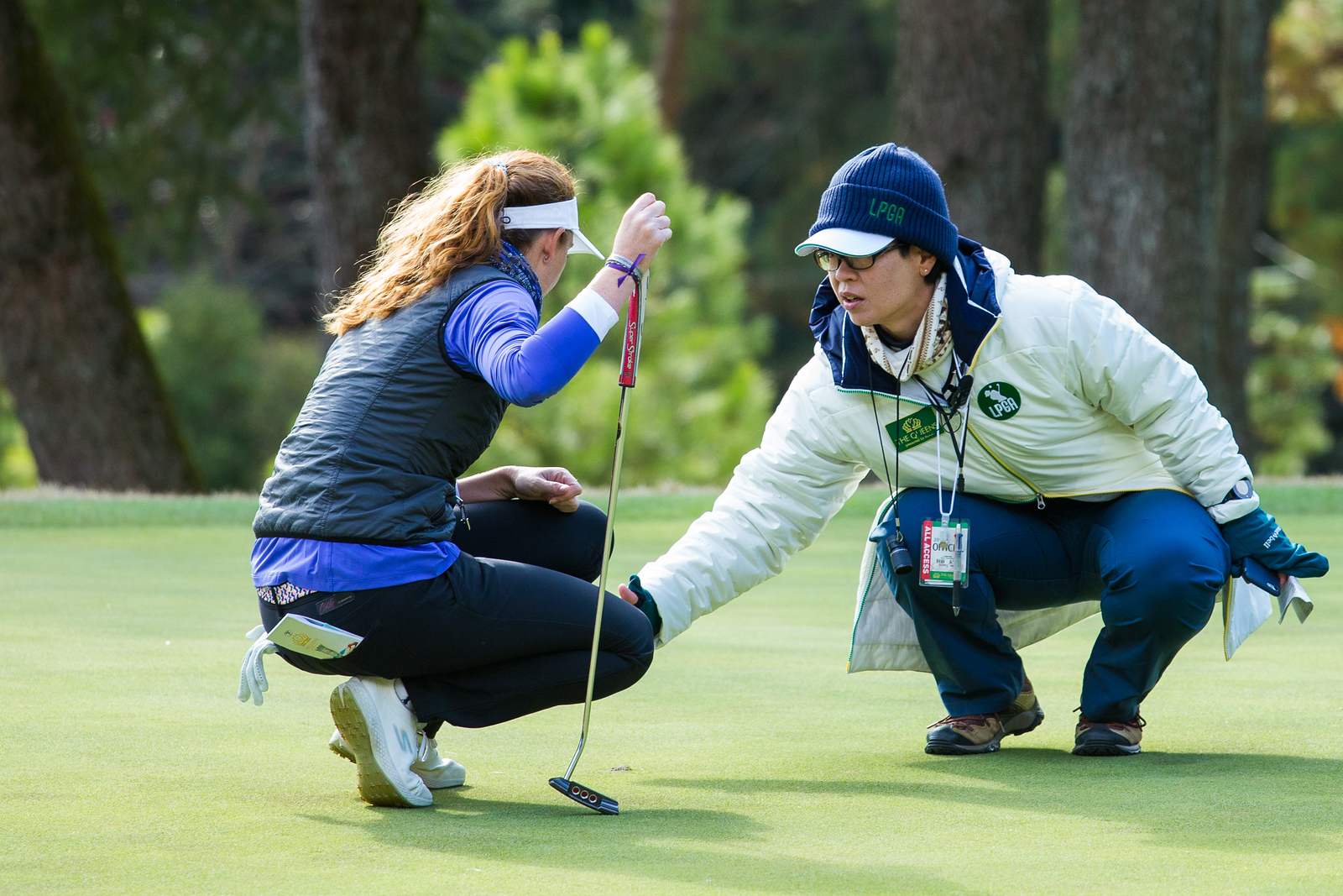 Florentyna Parker of England gets a ruling on the 16th green