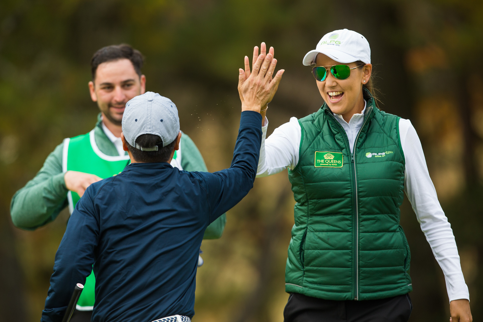 Whitney Hillier of Australia high fives her playing partner during the pro-am