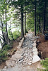 THE JORDAN POND TRAIL -- DURING<br /> The two side walls are built and crushed rock is laid between them to serve as a base for the gravel to nestle into. It keeps the gravel in place better than just throwing it down by itself, which would become disturbed under traffic.