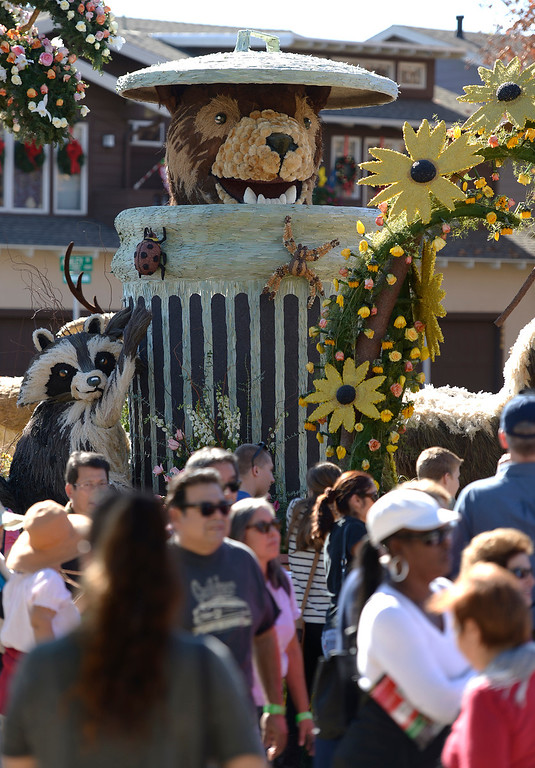 """. The City of Glendale float featured \""""Meatball,\"""" the bear who liked to show up and eat from trash cans on trash days. Even though captured a number of times, and returned to the mountains, Meatball would find his way back into Glendale to scavenge on trash days. The 125th Rose Parade\'s Showcase of Floats was staged on Sierra Madre Boulevard between Washington Boulevard and Sierra Madre Villa Avenue, and Washington Boulevard between Sierra Madre Boulevard and Woodlyn Road.  Pasadena, CA January 1, 2014.(John McCoy/Los Angeles Daily News)"""