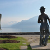 a bronze statue of Charlie Chaplin stares at the Giant Fork in Lake Geneva at Vevey where he lived and died
