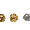 Silver and gold coins from ancient rome, minted during the reign of the Emperor Vespasian.