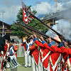 NENDAZ, SWITZERLAND – JULY 21: Grenadiers discharging muskets  at the 11th International Festival of Alpine horns :  July 21, 2012 in Nendaz Switzerland