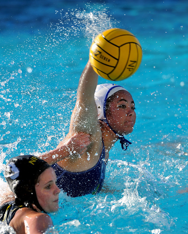 . Agoura\'s Lauren Rothermel unloads against Newbury Park as Cambria Middleton defends, Wednesday, January 29, 2014, at Newbury Park. (Photo by Michael Owen Baker/L.A. Daily News)