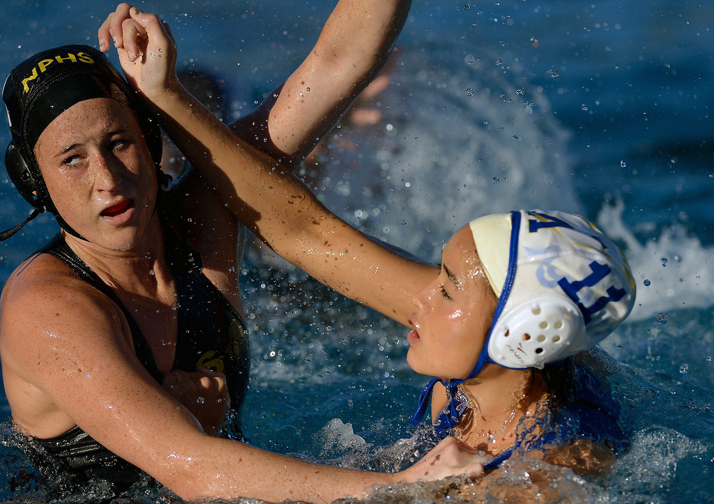 . Newbury Park\'s Elise Begg, left, and Agoura\'s Aley Vilches mix it up, Wednesday, January 29, 2014, at Newbury Park. (Photo by Michael Owen Baker/L.A. Daily News)