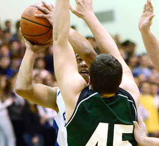 Ed Burke - The Saratogian 02/04/14; Sartoga's Jesse Alexander looks for room past Shen guard Erik Kromer during the Blue Streaks' loss to the Plainsmen Tuesday night in Saratoga.
