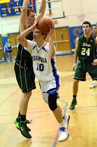 Ed Burke - The Saratogian 02/04/14; Saratoga's Noah Arciero is pressured by Shen's Brandon Fischer during the Blue Streaks' loss to the Plainsmen Tuesday night in Saratoga.