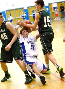 Ed Burke - The Saratogian 02/04/14; Saratoga's Chris Byno gets squeezed trying to get past Shen defenders Erik Kromer, left, and Thomas Heurter during the Blue Streaks' loss to the Plainsmen Tuesday night in Saratoga.